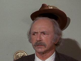 Grandpa Joe's hat is taken by the thoughtful coatrack.